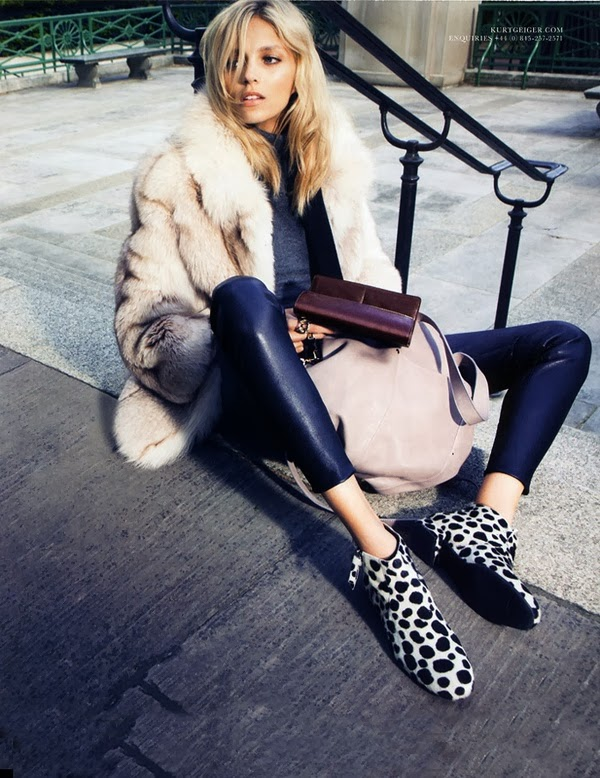 The Combination of White Fur Coat with Black Leather Trousers and Amazing Leopard Patterned Shoes
