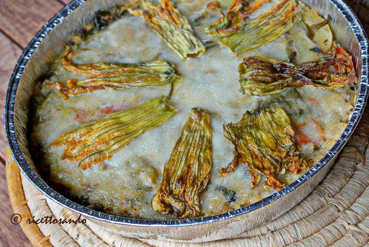 Timballo di riso con tenerumi e fiori di zucchina cuociamo a forno caldo
