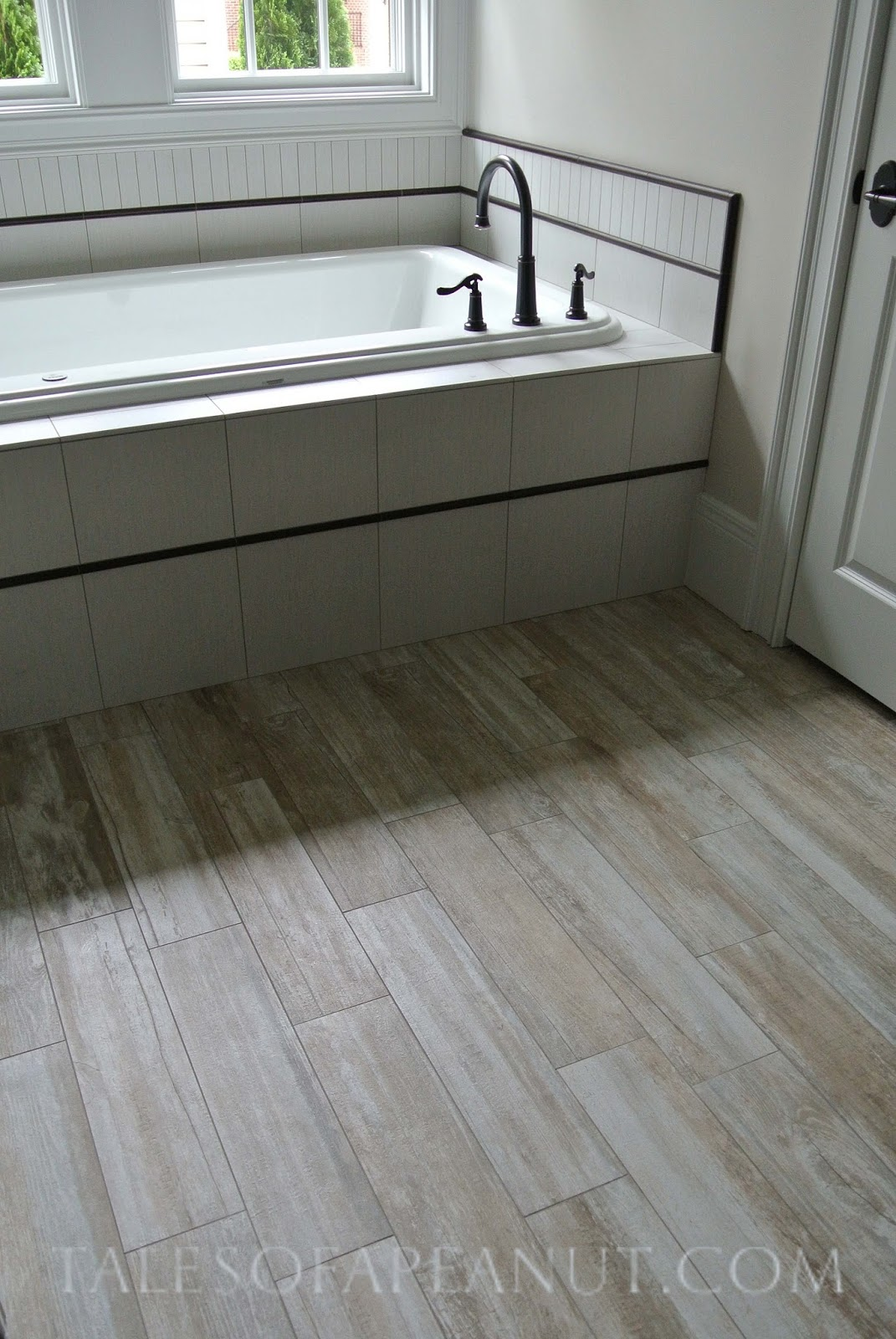Bathrooms with wood tile floors home decoration club for Wood floor bathroom