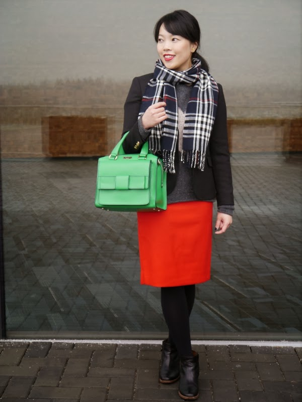 Plaid scarf, red pencil skirt, and a green Kate Spade bag worn with neutrals