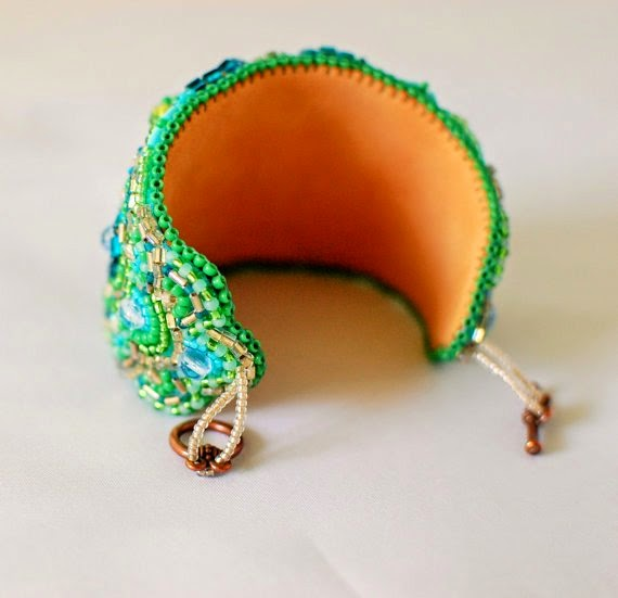 https://www.etsy.com/listing/189376695/wide-bracelet-green-magic-beaded-emerald?ref=favs_view_3