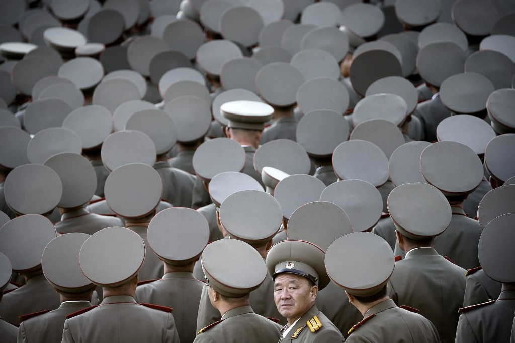 70 Of The Most Touching Photos Taken In 2015 - Veterans turn toward their North Korean leader Kim Jong Un as he delivers a speech during a military parade in Pyongyang, North Korea.