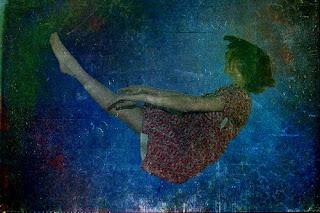 Image of woman sinking into the ocean, copyright MJ Photography and Design - View her Flickr page here!