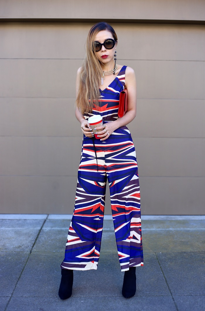 clover canyon dynamic sunset jumpsuit, saint laurent clutch, pointy toe ankle booties, starbucks holiday red cup, baublebar statement choker necklace, baublebar drop earrings, prada sunglasses, fashion blog, street style, holiday outfit, holiday jumpsuit, holiday outfit ideas