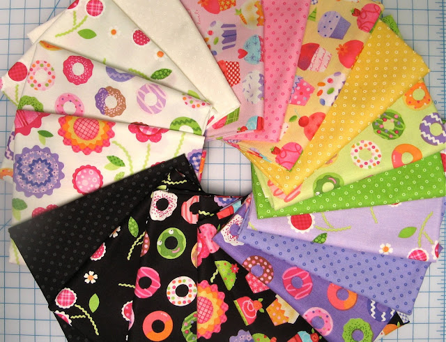 pink, green, yellow, lavender, black and white girl fabric with cupcakes