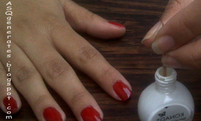 Dip toothpick in white nail polish