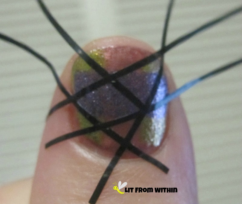 take a few pieces of tiny striping tape, and lay them across the nail