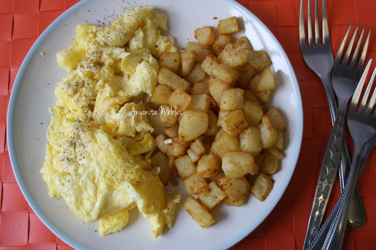 A Plate Of Eggs And Breakfast Potatoes Made In The Actifry From Anyonita