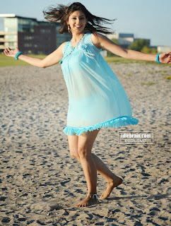 Tanvi Vyas in a Sky Blue Transparent Sleeveless Short Top Stunning Smile Beautiful Pics