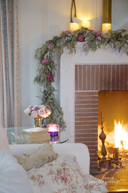 Winter garland on mantel with flowers and eucalyptus