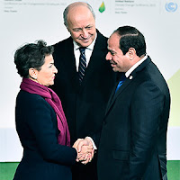 U.N. climate chief Christiana Figueres shakes hands with Egyptian President Abdel Fattah el-Sisi at Paris talks. (Credit: Getty Images) Click to Enlarge.