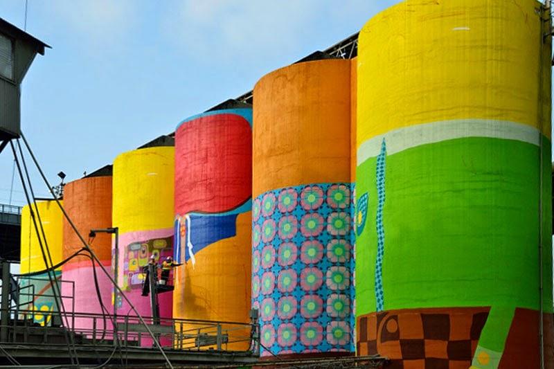 Os Gemeos colorean seis silos gigantes
