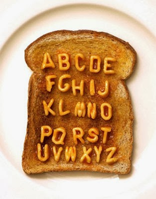 Image of the Alphabetti Spaghetti alphabet on a slice of brown toast with