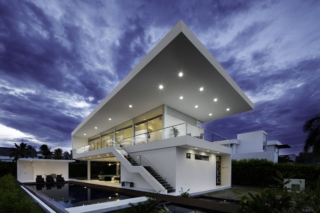 Modern home with lights at dusk