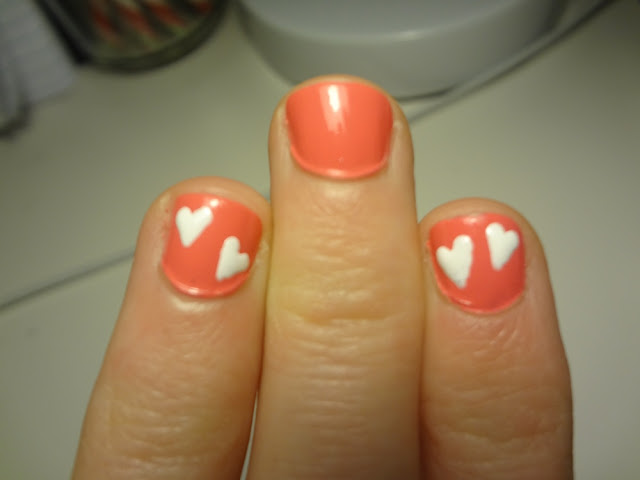 valentine's day nails, white hearts on sally hansen coral reef