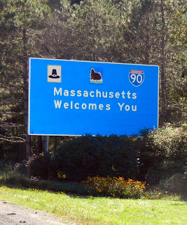 The state line sign in Massachusetts on Interstate 90