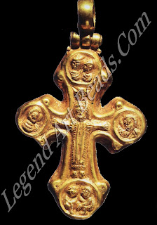 The design of this cross, with repousse figures and medallions at the ends, was popular, and it continued to be used into the 12th century. Christ is depicted wearing a colobium, a simple sleeveless linen robe from Roman times that came to symbolize humility before God. The colobium dates the cross to the 6th or 7th century, as later crosses favored Christ dressed in a loincloth.