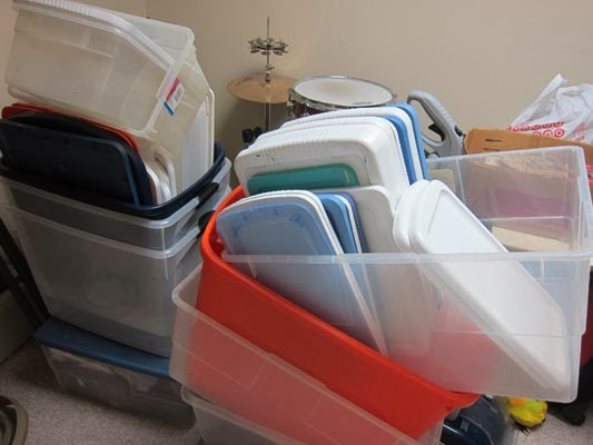 pile-of-used-storage-bins-in-basement