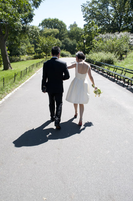Couple walks through Central Park after Central Park Wedding