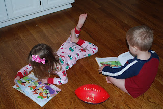 siblings reading together, kids enjoying reading, kids reading to themselves