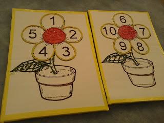Tabuleiro (amarelo) do jogo das flores para trabalhar número e quantidade