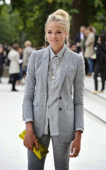 Grey coat and dost grey shirt and grey pant and golden clutch