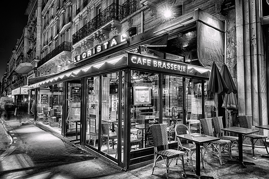 Le Crystal Cafe Brasserie at night in black and white Paris restaurant