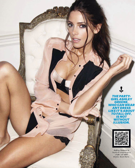 Ashley Greene wearing black lingerie and sitting in a chair