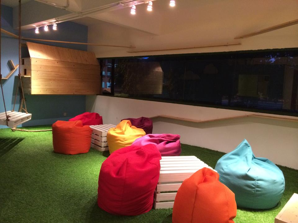 Plenty Of Bean Bag Chairs And A Cute Swing