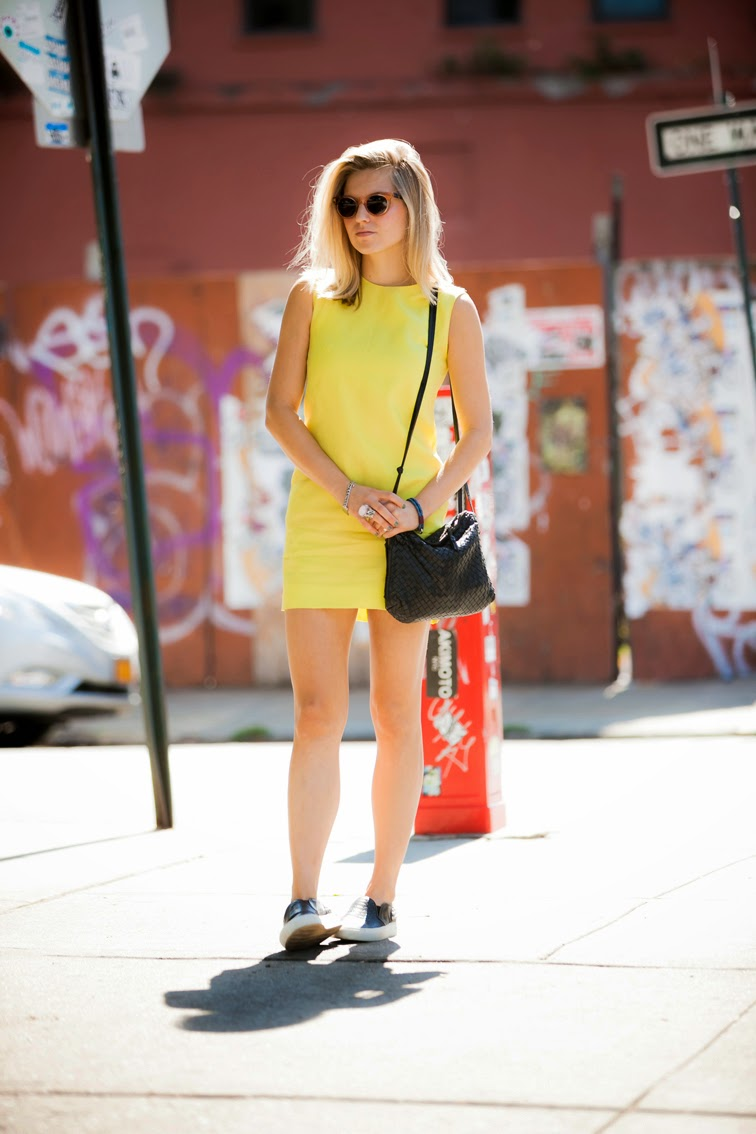 Bally yellow dress Raen Arkin sunnies Sandro slip-on sneakers Saint Laurent arty ring Bottega Veneta Intrecciato