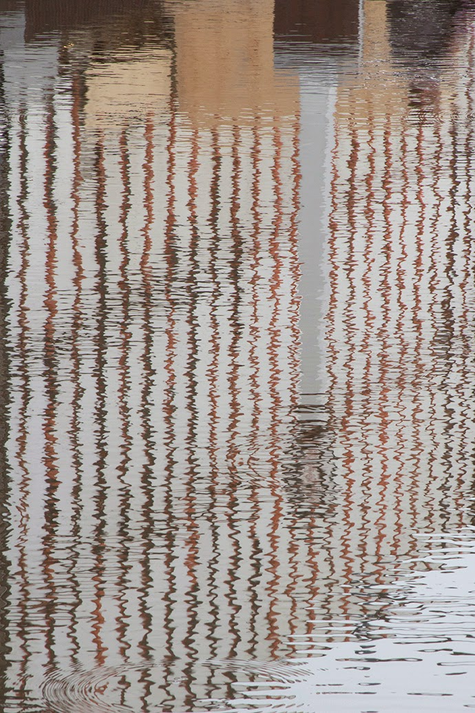 reflection of a column and lots of stripes