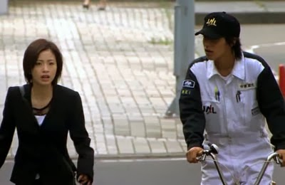Nishikido Ryo as Nakahara approaches Misaki on a bicycle.