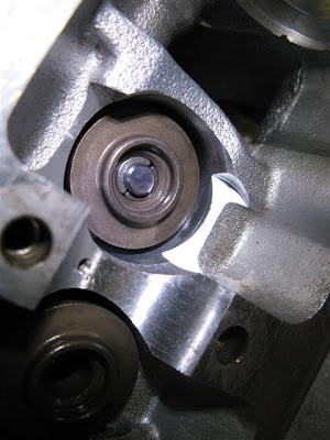 Installed valve springs lock in head