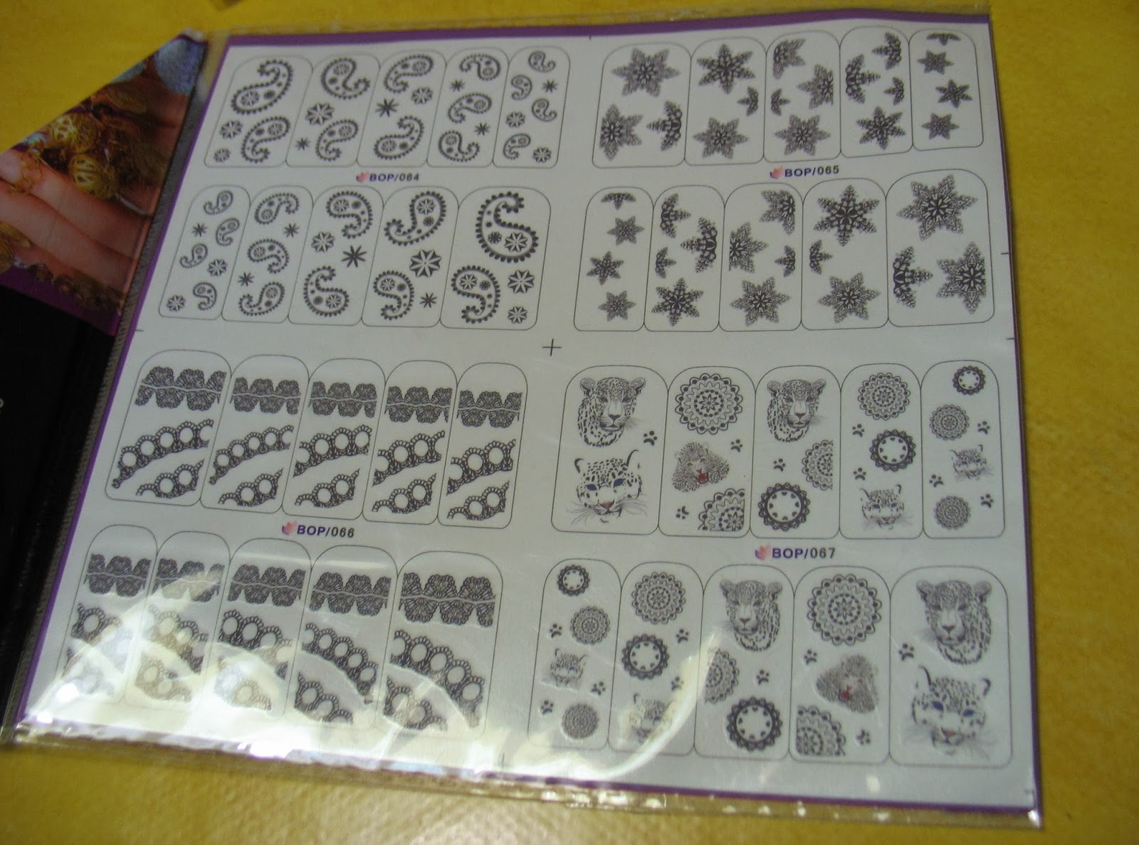 http://www.bornprettystore.com/4pcs-nail-water-decals-stickers-black-star-ripple-leopard-wheel-patterns-p-5627.html