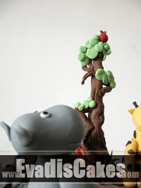 Picture of hippo looking at apple on tree