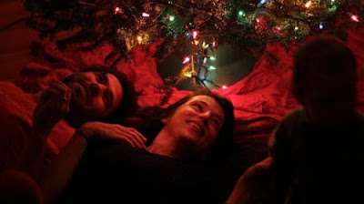 laying under Christmas tree