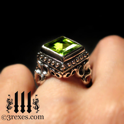silver raven love gothic wedding ring with green peridot