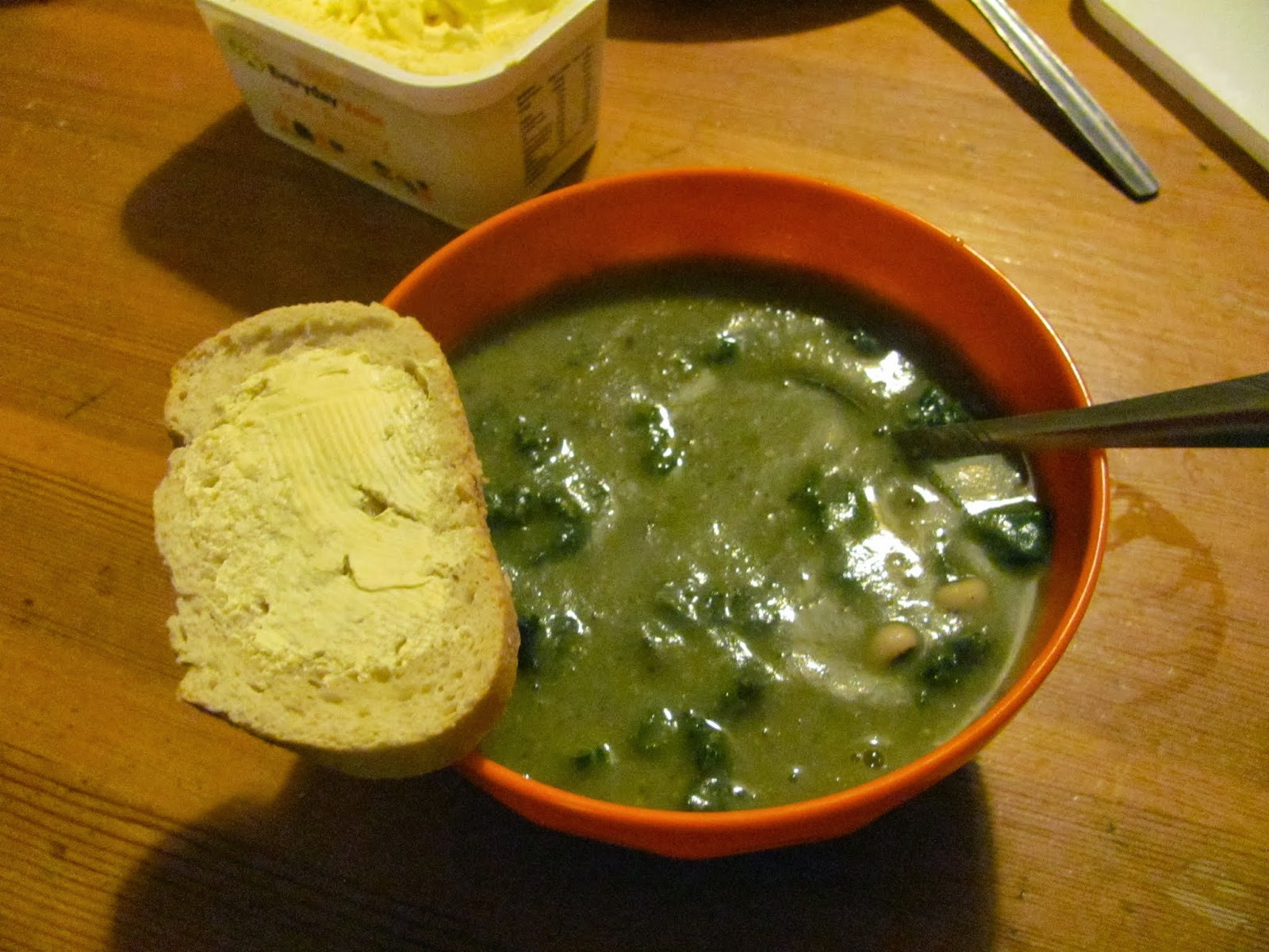 Soup is served with a slice of homemade bread