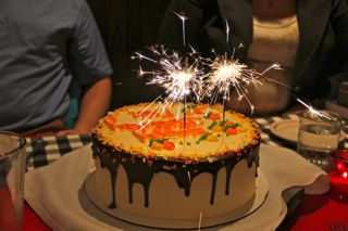 photo of birthday cake with sparklers