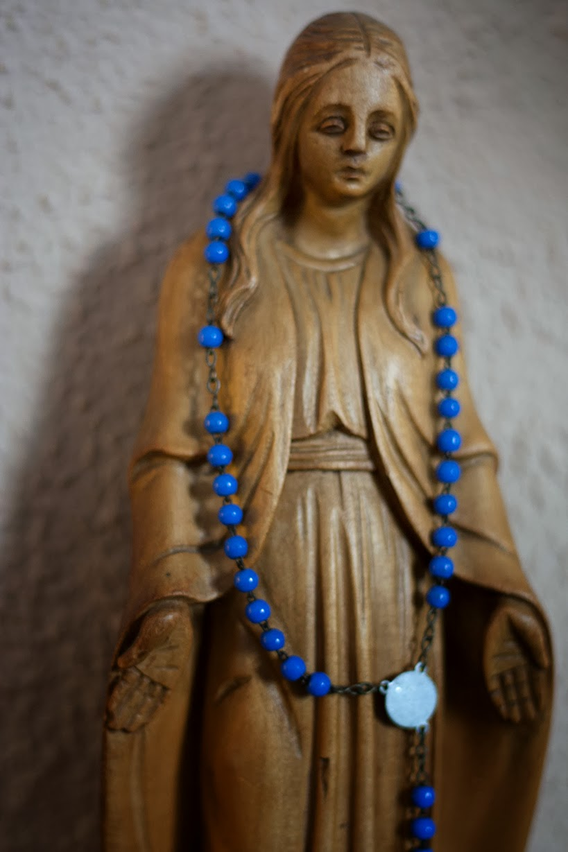 Maria with rosary