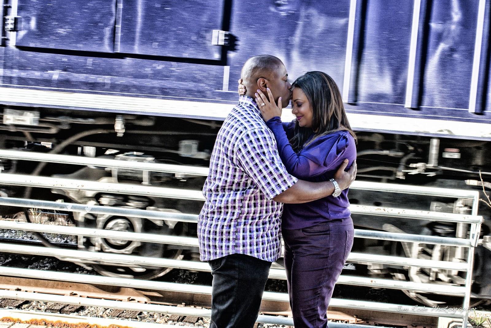 engagement kiss on Irving train platform