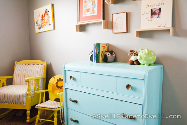 Teal Dresser with yellow rocking chairs // www.aswellplacetodwell.com