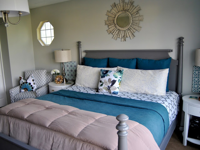 master bedroom, teal master bedroom, turquoise master bedroom, blue master bedroom, calm, designed, blogger, king size bed, sunburst mirror above bed, sunburst mirror, oval night stands, white night stands, gray bed, aloof gray, accent chair, 12 drawer dresser, malm dresser, white drum chandelier, drum chandelier, chandelier