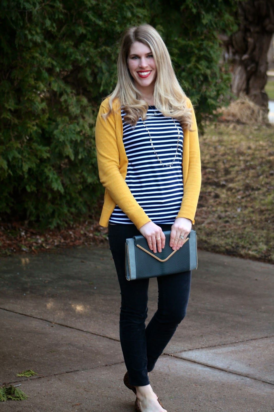 blue striped top, mustard cardigan, grey corduroy pants, leopard flats, grey envelope clutch, layered necklaces