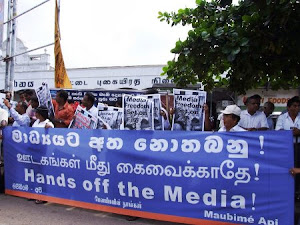 Journalists Protest Press Burning Amidst Anger and Frustration
