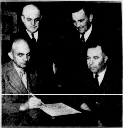 W.C. Tuttle (sitting on the left) getting re-elected as President of the Pacific Coast Baseball League in 1936