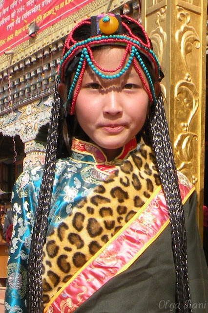 Tibetan girl wearing turquoise coral and amber head ornament