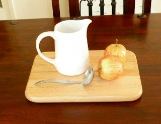 the milk jug and apples