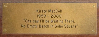 photograph of memorial plaque from a park bench