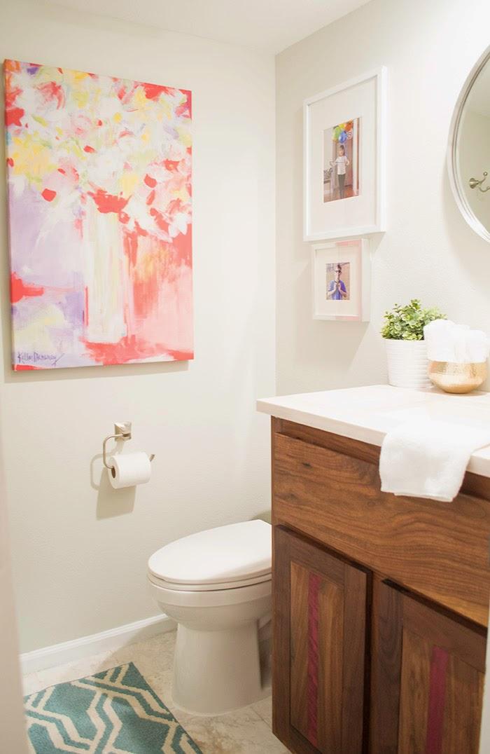 red wallpaper to light paint, benjamin moore titanium, walnut cabinet, walnut vanity cabinet, purple heart inlay, home depot bathroom counter with sink, ikea grundtal mirror, new costco toilet, target rug,